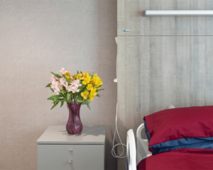 St Josephs Hospice bedside with flowers in vase