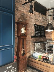 Caffe Nero- interior view of end of counter and clock