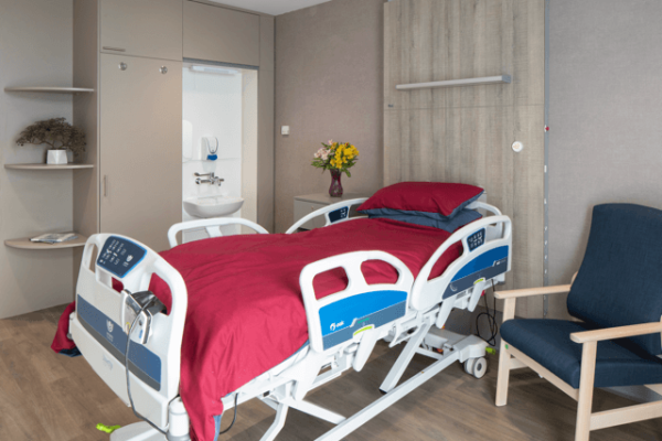 St Josephs Hospice view of adaptable bed and bedside chair