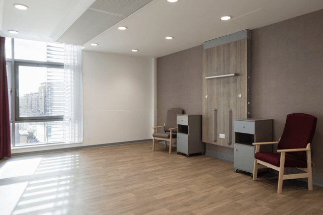 St Josephs Hospice large room with bright window opening
